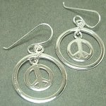 Sterling silver peace sign in circle.